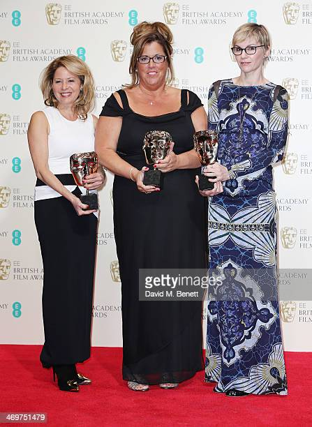 Katherine Gordon Lori McCoy Bell Elvyene Moraz winners of the Make Up and Hair award pose in the winners room at the EE British Academy Film Awards...