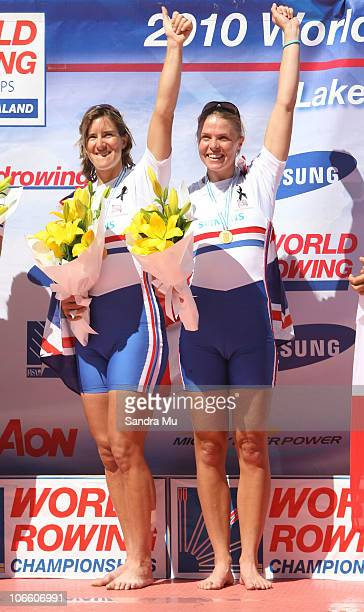 Katherine Grainger and Anna Watkins of Great Britain celebrate gold on the podium after the Women's Double Sculls Final during day eight of the World...