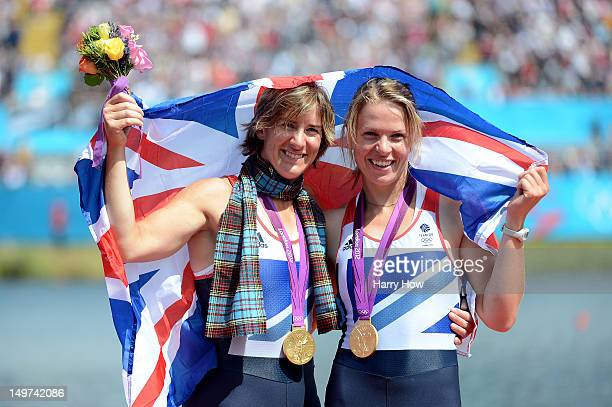 Katherine Grainger and Anna Watkins of Great Britain celebrate with their gold medals draped in a Union Jack during the medal ceremony for the...