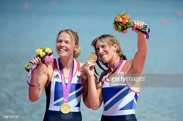 Katherine Grainger and Anna Watkins of Great Britain celebrate with their gold medals during the medal ceremony for the Women's Double Sculls final...