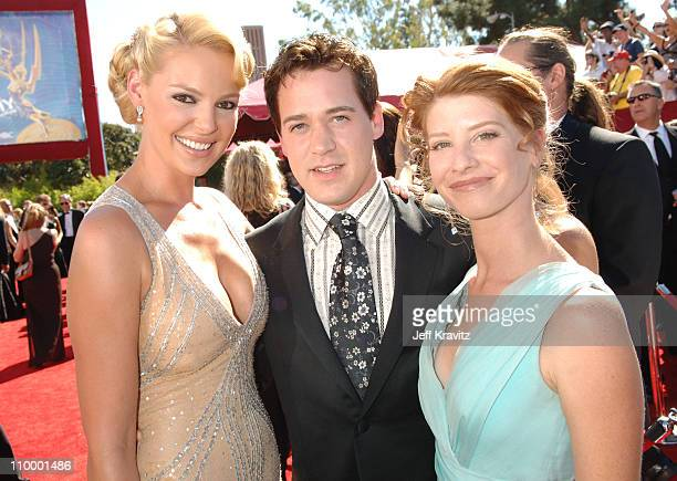 Katherine Heigl TR Knight and guest during 58th Annual Primetime Emmy Awards Red Carpet at The Shrine Auditorium in Los Angeles California United...
