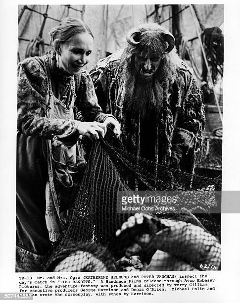 "Katherine Helmond and Peter Vaughan as Mr. And Mrs. Ogre inspects the days catch in a scene from the movie ""Time Bandits"". Circa 1981."