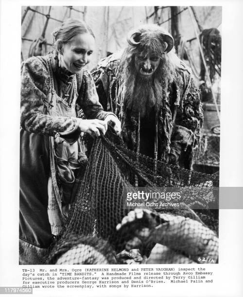 Katherine Helmond and Peter Vaughan inspect the day's catch in a scene from the film 'Time Bandits', 1981.