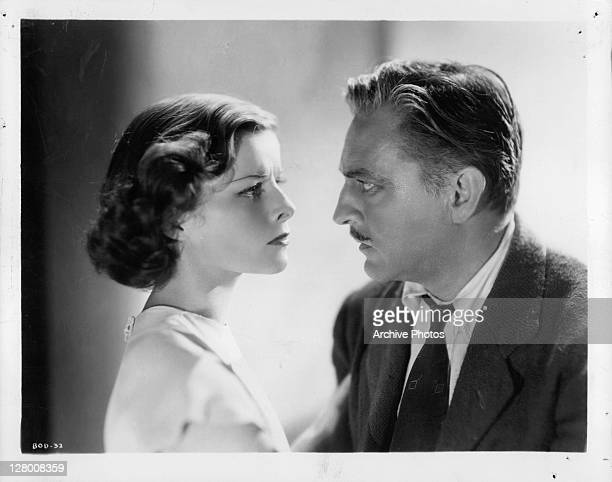Katherine Hepburn And John Barrymore look into each others eyes in a scene from the film 'Bill Of Divorcement' 1932