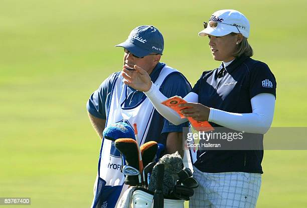 Katherine Hull of Australia chats with her caddie on the 18th hole during the first round of the ADT Championship at the Trump International Golf...