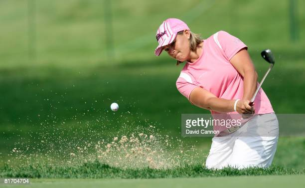 Katherine Hull of Australia plays from the sand at the 14th hole during a practice round prior to the 2008 US Women's Open at Interlachen Country...