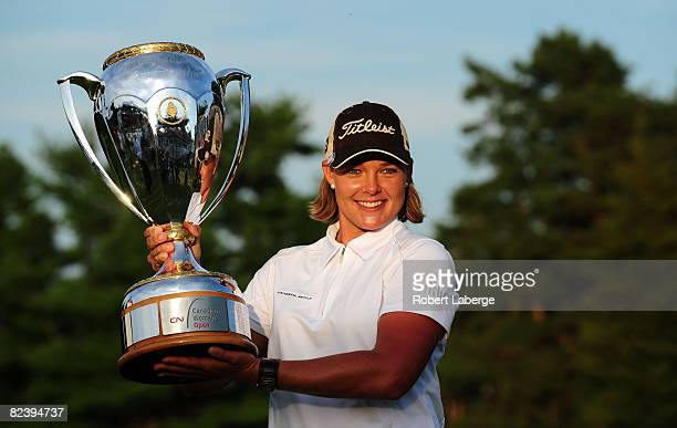 Katherine Hull of Australia poses with the winner's trophy after winning the CN Canadian Women's Open at the Ottawa Hunt and Golf Club on August 17,...