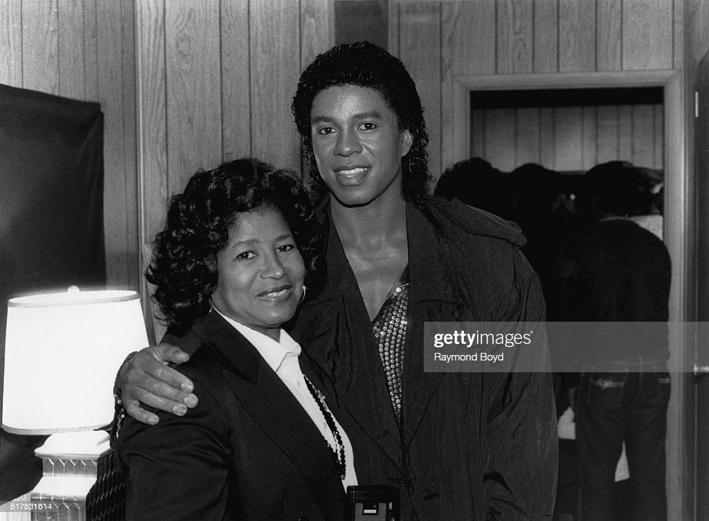 Katherine Jackson and Jermaine Jackson from The Jacksons poses for photos backstage in their trailer prior to going on stage during The Jacksons 'Victory Tour' at Comiskey Park in Chicago, Illinois on October 12, 1984.