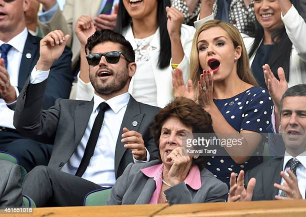 Katherine Jenkins and Andrew Levitas attend the Angelique Kerber v Maria Sharapova match on centre court during day eight of the Wimbledon...