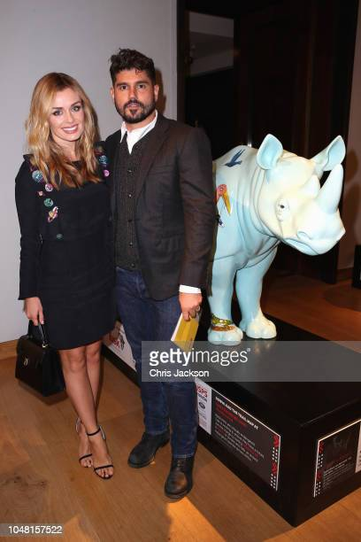 Katherine Jenkins and Andrew Levitas attend the private view and sale of a unique collection of rhino sculptures and works of art curated by Chris...