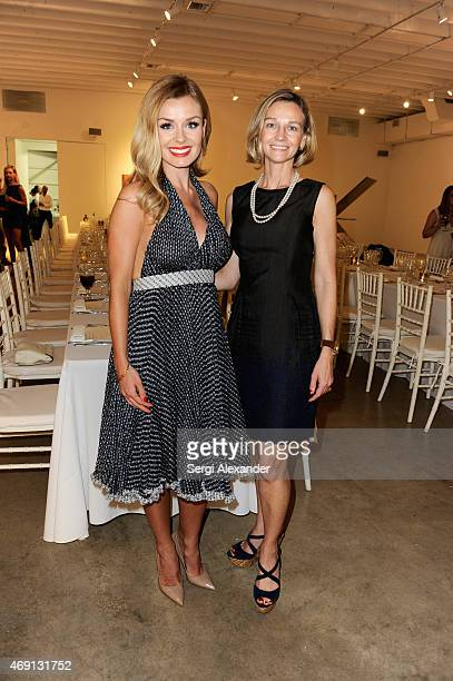Katherine Jenkins and Dr Carla Albarran attend Andrew Levitas Metalwork Playground Private Dinner at Blueshift Wynwood on April 9 2015 in Miami...