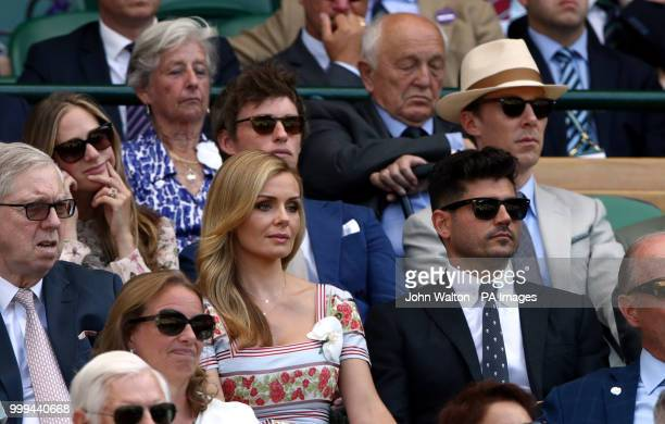 Katherine Jenkins Andrew Levitas Benedict Cumberbatch and Eddie Redmayne in the royal box on centre court on day thirteen of the Wimbledon...