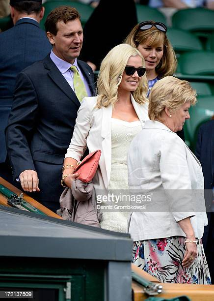 Katherine Jenkins Darcey Bussell and Angus Forbes take their seats in the Royal Box before the Ladies' Singles quarterfinal match between Agnieszka...
