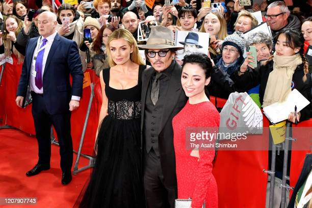 Katherine Jenkins Johnny Depp and Minami attend the Minamata Premiere at the 70th Berlinale International Film Festival Berlin at Grand Hyatt Hotel...
