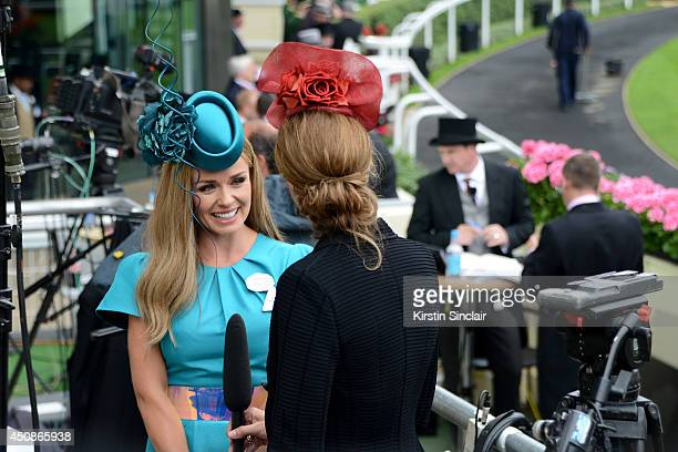 Katherine Jenkins speaks to a reporter as she attends day three of Royal Ascot at Ascot Racecourse on June 19 2014 in Ascot England