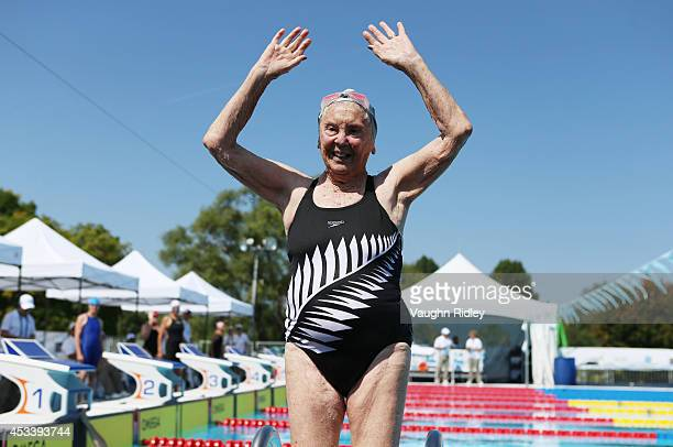 Katherine Johnstone of New Zealand waves after completing the Women's 400m Freestyle during the 15th FINA World Masters Championships at Parc...