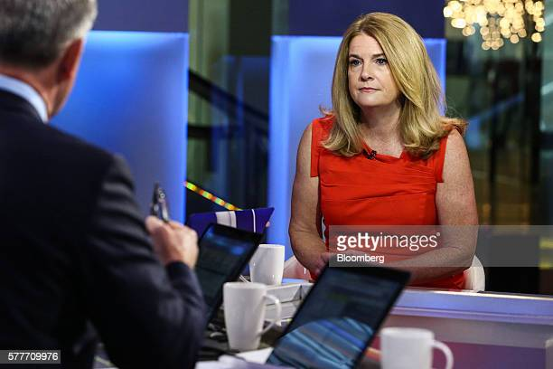 Katherine Katie Ellis Nixon chief investment officer of wealth management at Northern Trust Corp listens during a Bloomberg Television interview in...