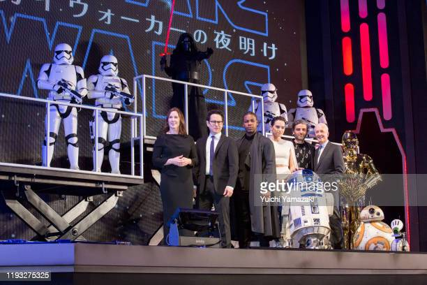 Katherine Kennedy, J.J. Abrams, John Boyega, Daisy Ridley, Oscar Isaac and Anthony Daniels with Star Wars characters Stormtrooper, Kylo Ren, R2-D2,...