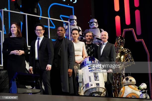Katherine Kennedy JJ Abrams John Boyega Daisy Ridley Oscar Isaac and Anthony Daniels with Star Wars characters Stormtroopers Kylo Ren R2D2 C3PO BB8...