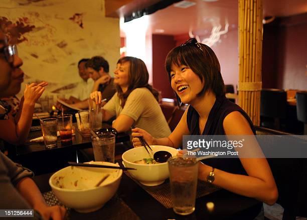 Katherine Kim enjoys her bowl of Gojiramen with extra corn at Sakuramen Ramen Bar on Tuesday July 5th 2012