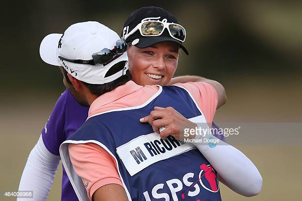 Katherine Kirk of Australia hugs the caddie of Marion Ricordeau of France on the 18th hole during day three of the LPGA Australian Open at Royal...