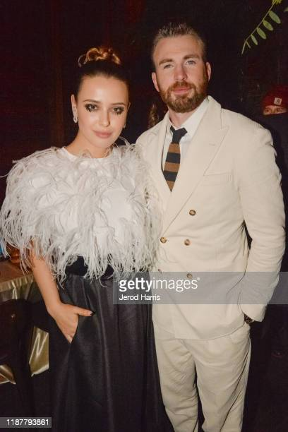Katherine Langford and Chris Evans attend the Premiere Of Lionsgate's 'Knives Out' - After Party at Baltaire Restaurant on November 14, 2019 in...