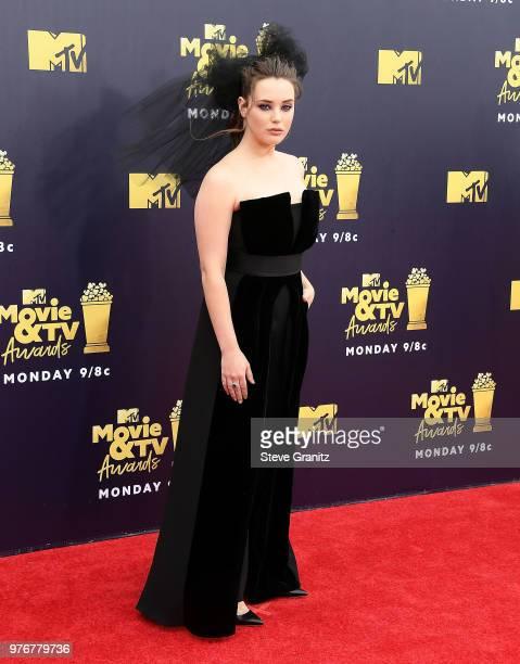 Katherine Langford arrives at the 2018 MTV Movie And TV Awards at Barker Hangar on June 16 2018 in Santa Monica California