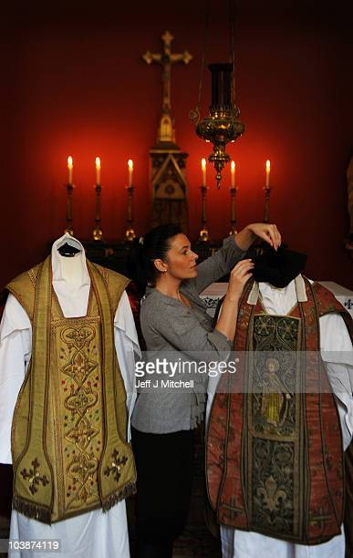 Katherine Milby stands beside two vestments owned by Cardinal Newman in the Chapel at Abbotsford House on September 7 2010 in Melrose Scotland...