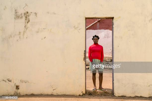 Katherine Ompi, 19 years old, an Internally Displaced Person , victim of rape and pregnant, poses at the headquarters of the NGO 'Haro - Cameroon',...