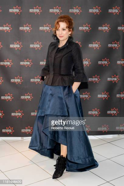 Katherine Parkinson attends a photocall for the UK Premiere of 'How To Fake a War' during the 73rd Edinburgh International Film Festival at Odeon on...
