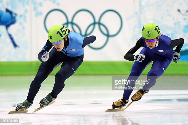 Katherine Reutter of the United States leads from Cho HaRi of South Korea in the Ladies' 1000m Short Track Speed Skating QuarterFinals on day 15 of...