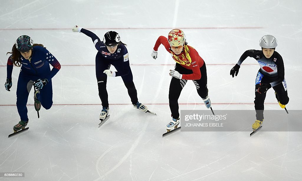 Katherine Reutter (LR) of the US, Deanna Lokette of Australia, Zang Yize of China and Saito Hitomi of Japan compete in the women's 1500m semifinal at the ISU World Cup Short Track speed skating event in Shanghai December 10, 2016 / AFP / Johannes EISELE