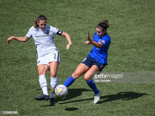 Katherine Reynolds of Portland Thorns FC fights for the ball with Jodie Taylor of OL Reign during a game on day 8 of the NWSL Challenge Cup at Zions...