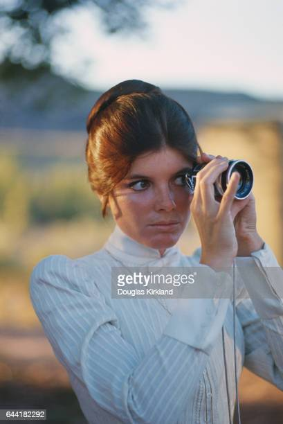 Katherine Ross uses a movie camera lens on the set of Butch Cassidy and the Sundance Kid