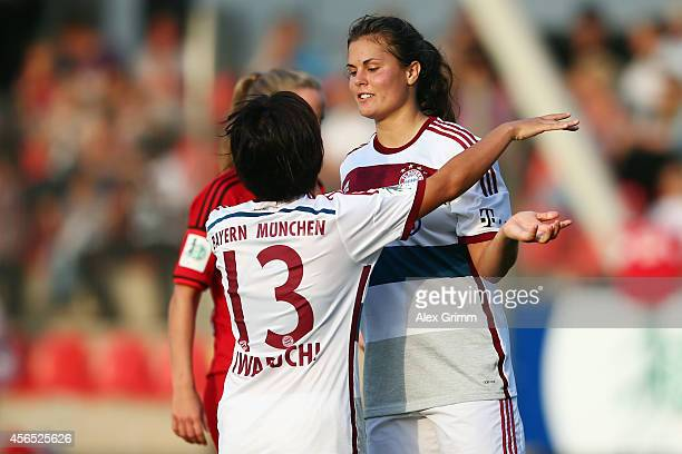 Katherine Stengel of Muenchen celebrates her team's second goal with team mate Mana Iwabuchi during the Allianz FrauenBundesliga match between Bayer...