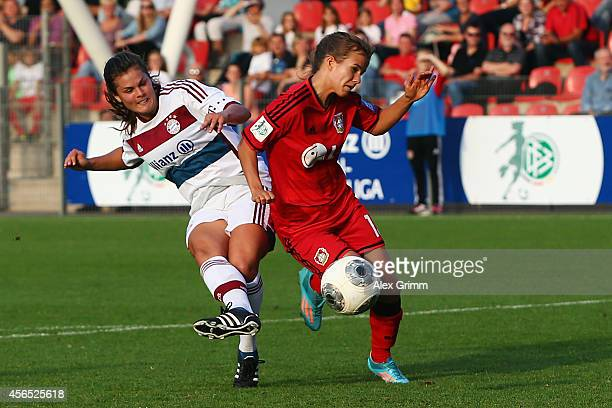 Katherine Stengel of Muenchen scores her team's second goal against Anna Gasper of Leverkusen during the Allianz FrauenBundesliga match between Bayer...