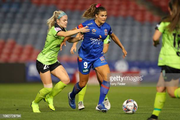 Katherine Stengel of the Jets contests the ball with Ellie Carpenter of Canberra during the round three WLeague match between the Newcastle Jets and...