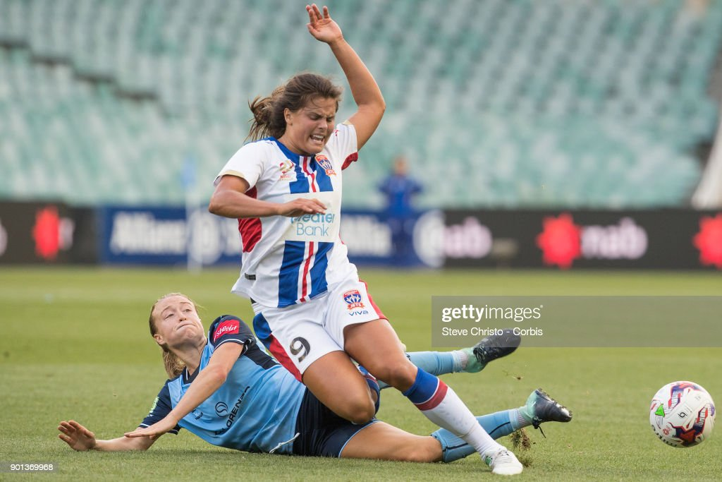 Katherine Stengel of the Newcastle Jets is tackled by Sydney FC's Emily Sonnett during the round ten W-League match between the Sydney FC and Newcastle Jets FC at Allianz Stadium on January 3, 2018 in Sydney, Australia.