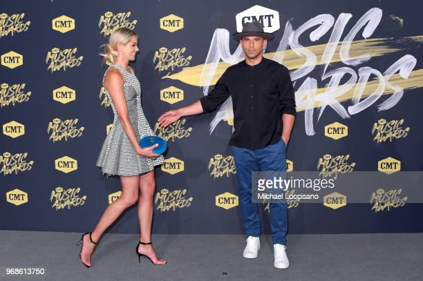 Katherine Stephans and Billy Dec attend the 2018 CMT Music Awards at Bridgestone Arena on June 6, 2018 in Nashville, Tennessee.