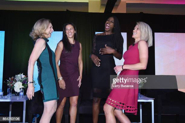 Katherine Switzer Carli Lloyd Chiney Ogwumike and Lisa Kerney share a laugh onstage during the WICT Leadership Conference at Marriott Marquis Times...