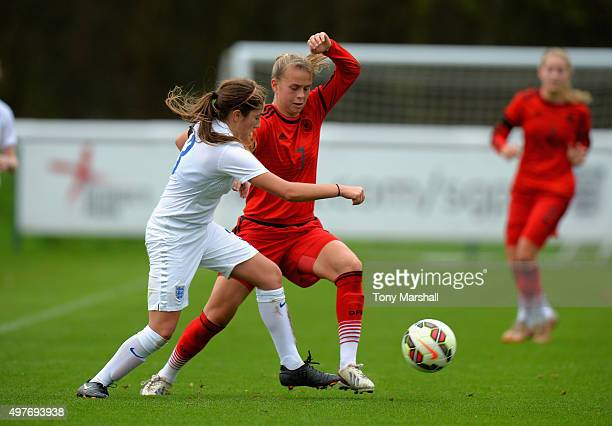 Katherine Turner of England is tackled by Klara Buhl of Germany during Women's U16s International Friendly match between England U16s Women and...