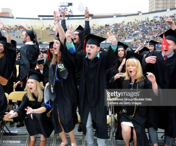 Katherine Wayne left Catherine Bogart Nick Altieri and Amanda Adkins jump for joy at the University of Colorado Commencement ceremony at Folsom Field...