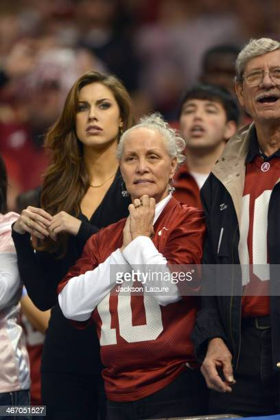 Katherine Webb girlfriend of quarterback AJ McCarron of the Alabama Crimson Tide reacts to second half action with McCarron's family during their...