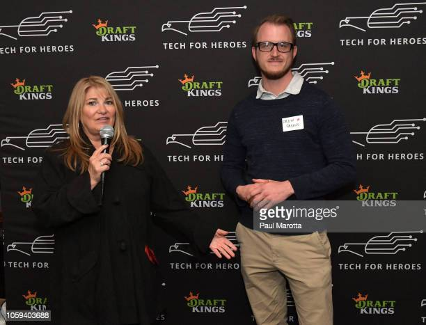 Katherine Webster and Drew Greene speak at DraftKings Hosts Veterans Appreciation Event at MJ O'Connors on November 8 2018 in Boston Massachusett