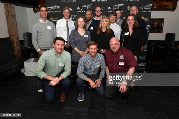 Katherine Webster poses with veterans at DraftKings Hosts Veterans Appreciation Event at MJ O'Connors on November 8 2018 in Boston Massachusett