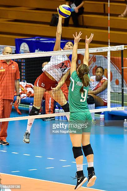 Katherinne Olemar of Peru spikes the ball in the match between Peru and Algeria during the FIVB Women's Volleyball World Cup Japan 2015 at Matsumoto...