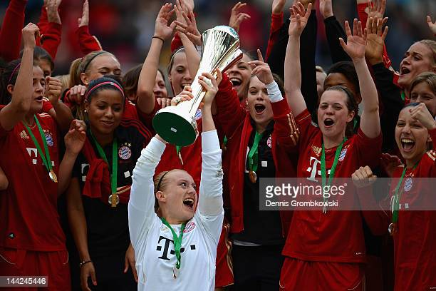 Kathin Laengert of Muenchen lifts the trophy after the Women's DFB Cup Final between 1 FFC Frankfurt and Bayer Muenchen at RheinEnergie Stadium on...
