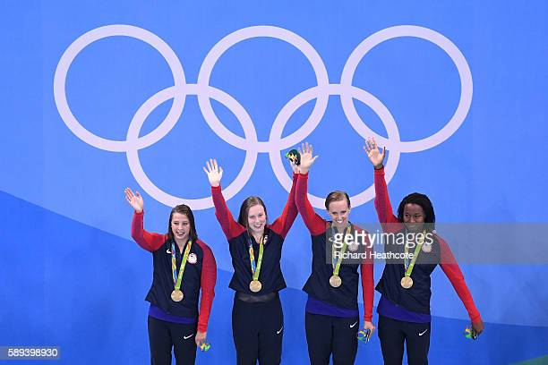 Kathleen Baker Lilly King Dana Vollmer Simone Manuel of the United States celebrate on the podium during the medal ceremony for the Women's 4 x 100m...
