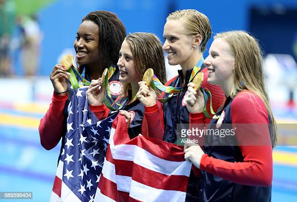 Kathleen Baker, Lilly King, Dana Vollmer, Simone Manuel of the United States pose during the medal ceremony for the Women's 4 x 100m Medley Relay...