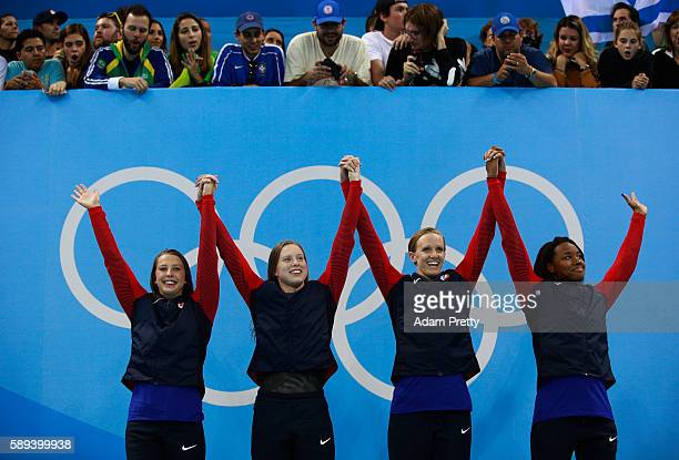 Kathleen Baker, Lilly King, Dana Vollmer, Simone Manuel of the United States celebrate on the podium during the medal ceremony for the Women's 4 x...